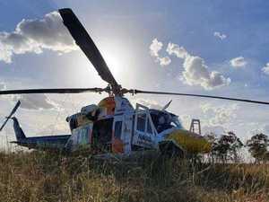 Young man hospitalised in motorbike beach crash
