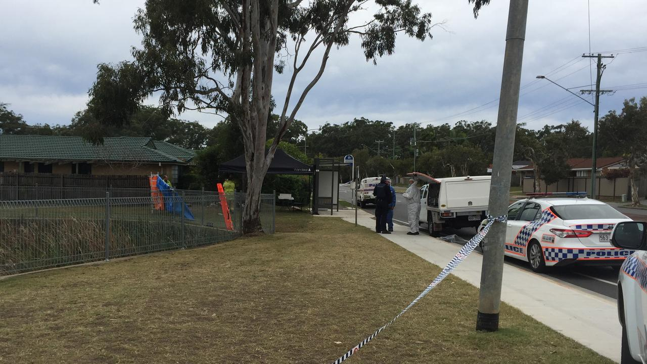 A creek is roped off as police investigate a body in Redland Bay. Photo: Marcel Baum
