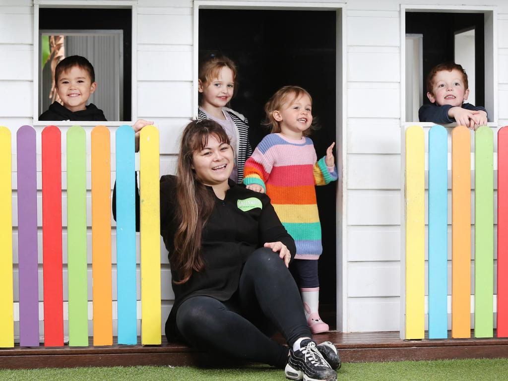 At a childcare centre in Waverley, educator Angela Castro with pre-schoolers Jet, Violet, Lola and Will. Experts are calling for flu shots to be mandatory for childcare workers. Picture: Richard Dobson