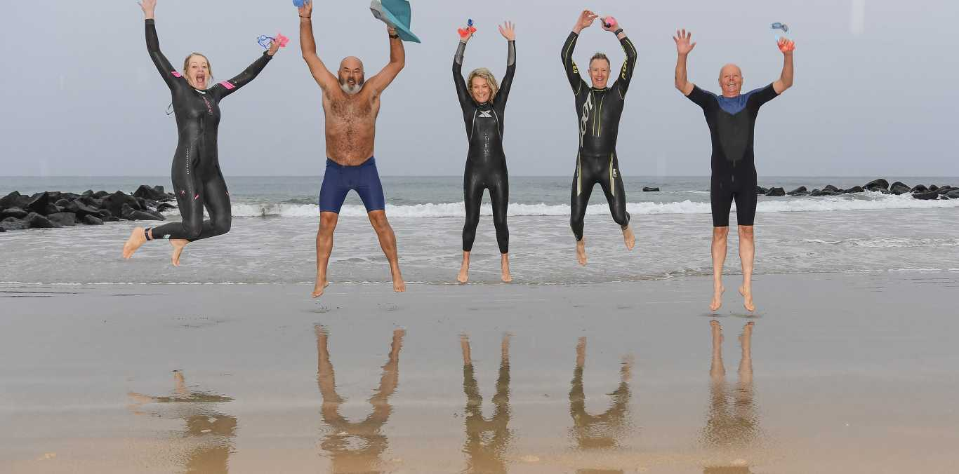 A little bit of rain and cold weather is not enough to stop Sue Phillips, Andy Kulibab, Elsie Norbery, Colin Stollery and Wayne Smith from their early morning dip.