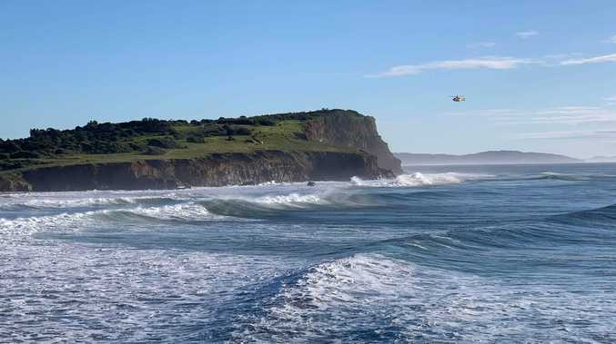 Surfer being 'bashed against rocks', rescue crews called