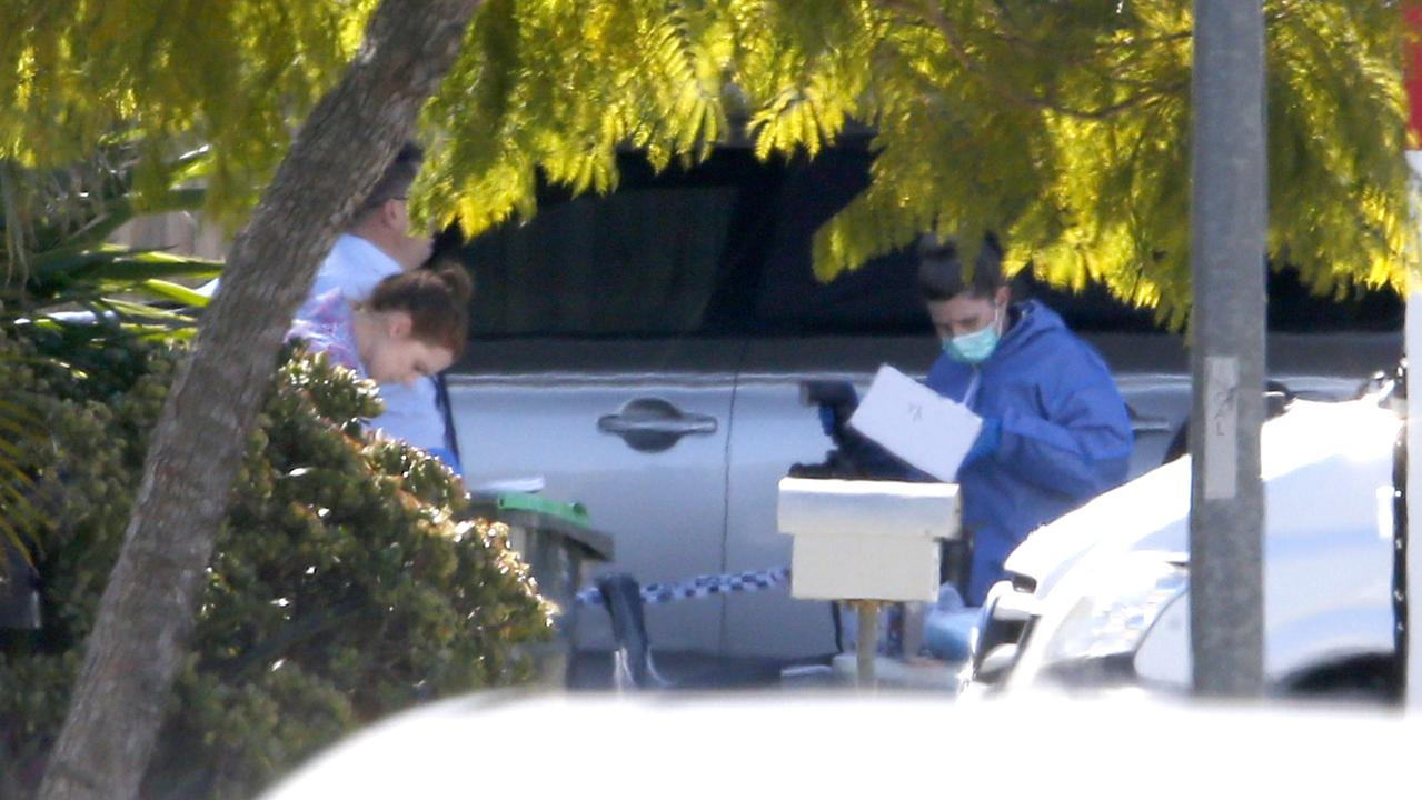 Police set up a crime scene as soon as they arrived. Picture: Steve Pohlner