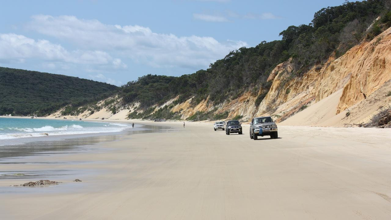 Beach driving with Noosa 4WD Eco Tours in the Cooloola Recreation Area of the Great Sandy National Park, Queensland.