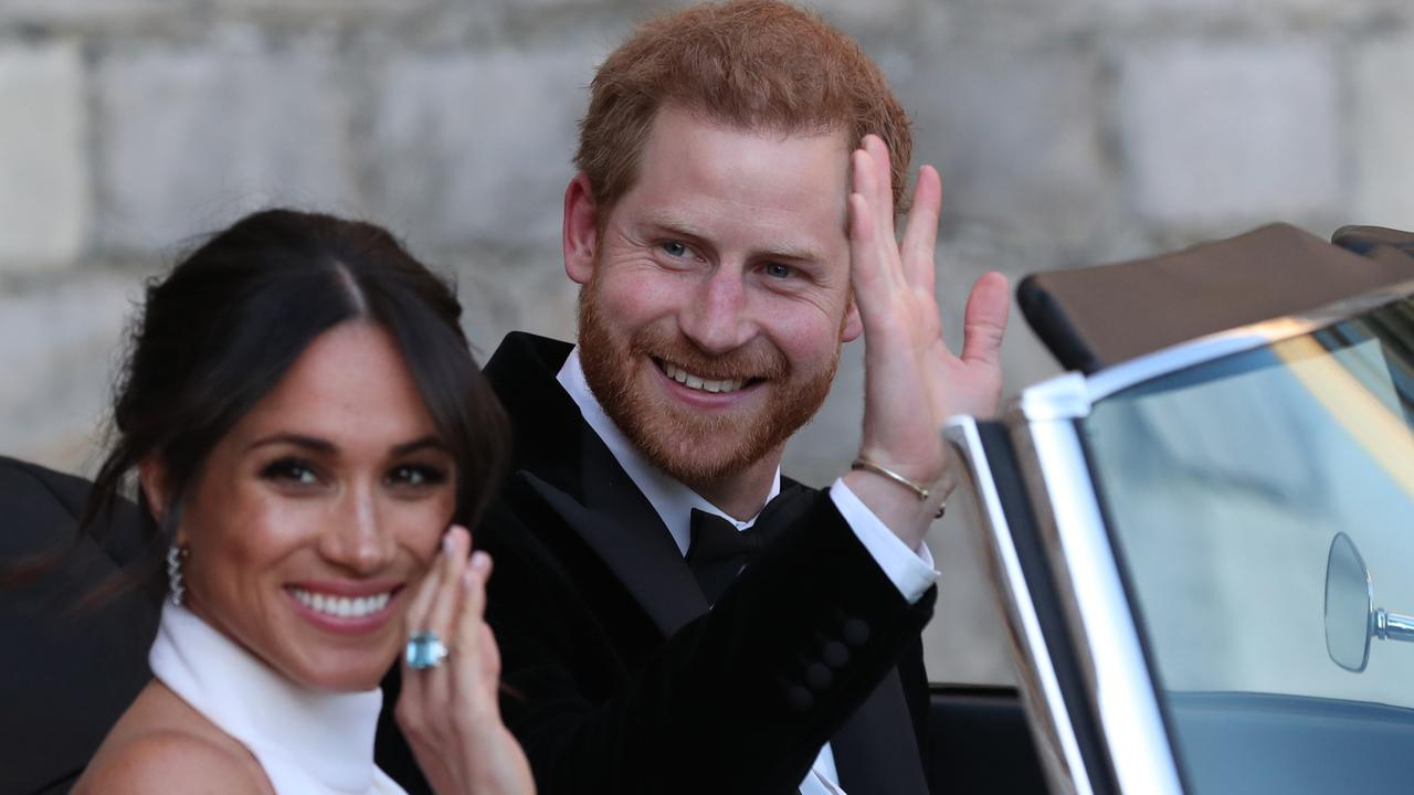 Meghan Markle and Prince Harry, Duke of Sussex wave as they leave Windsor Castle after their wedding. Picture: Getty Images