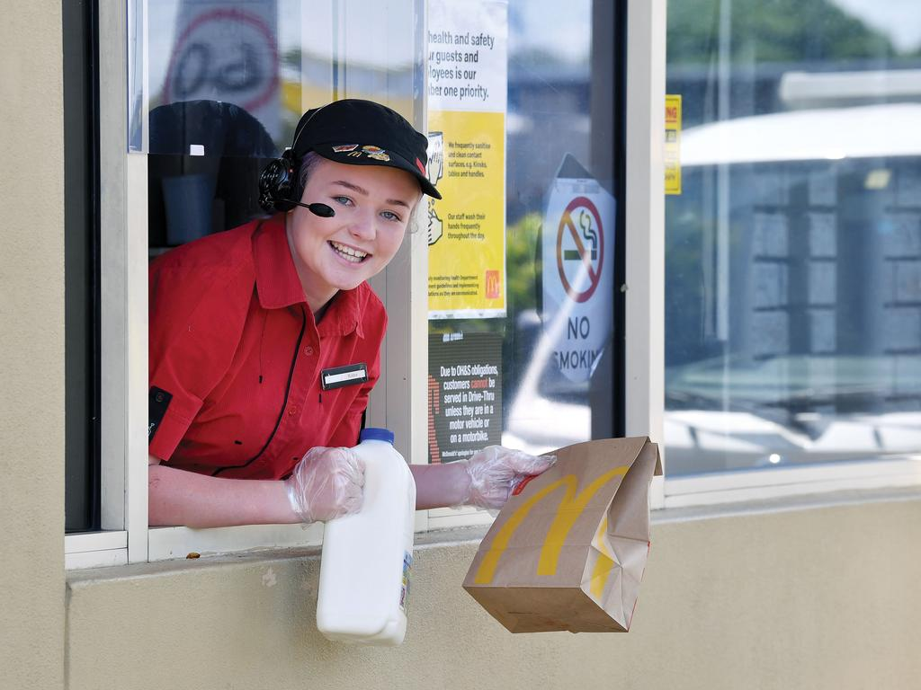 Kaley Coombs from McDonald's Mackay East with a bottle of milk that's now available from the store. Picture: Tony Martin