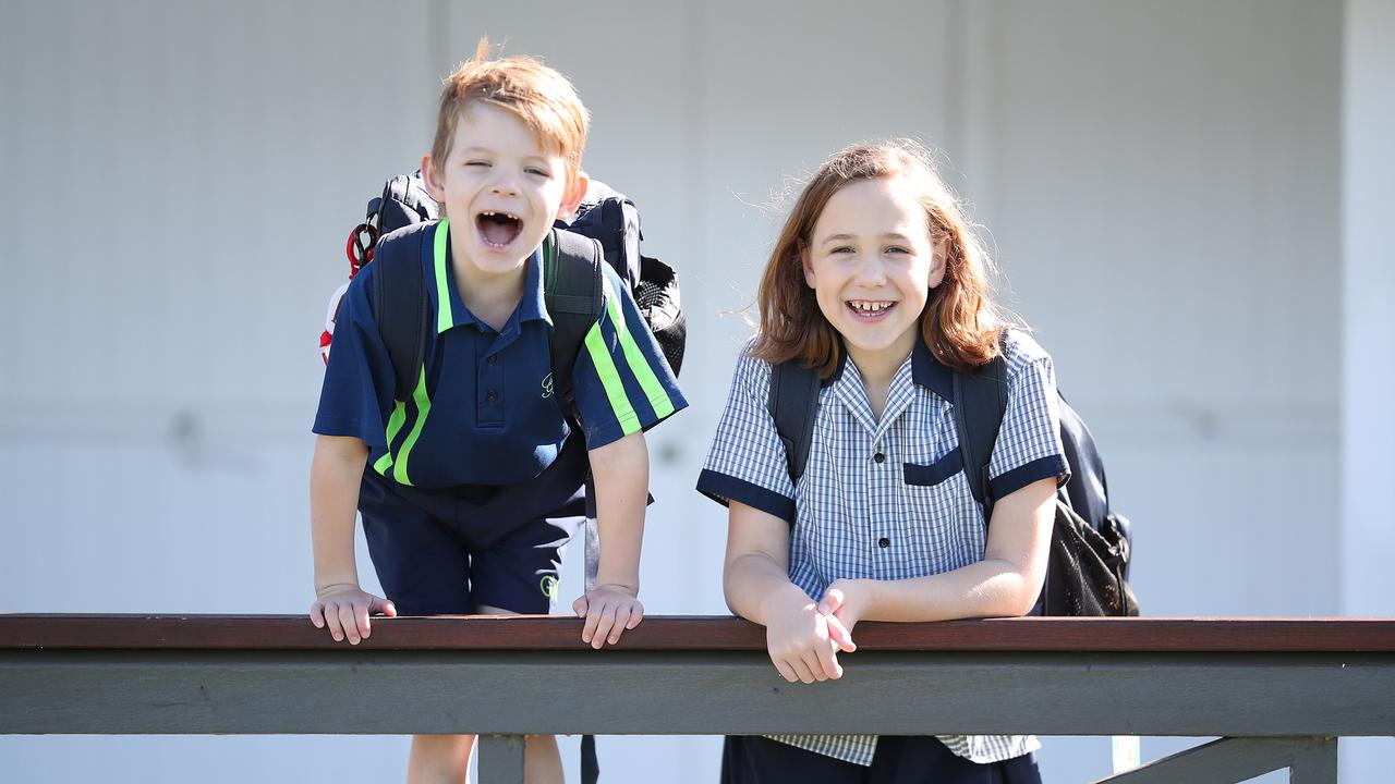 Jacob Polkinghorne, 5, and sister Hannah, 9, are happy to be going back to school. Picture: Peter Wallis