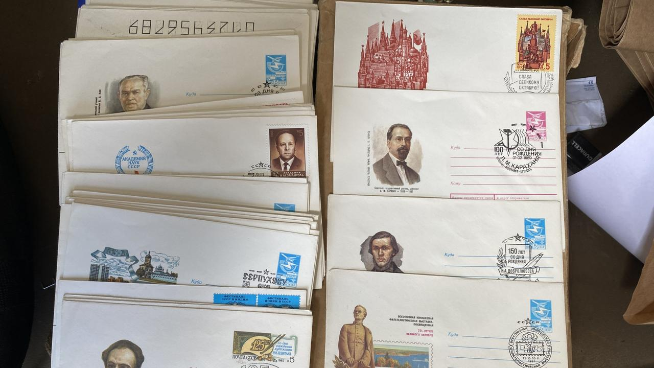 A collection of postal items believed to be 'first day covers' were allegedly found during a search of a Maryborough property in May 2020. PHOTO: Contributed.