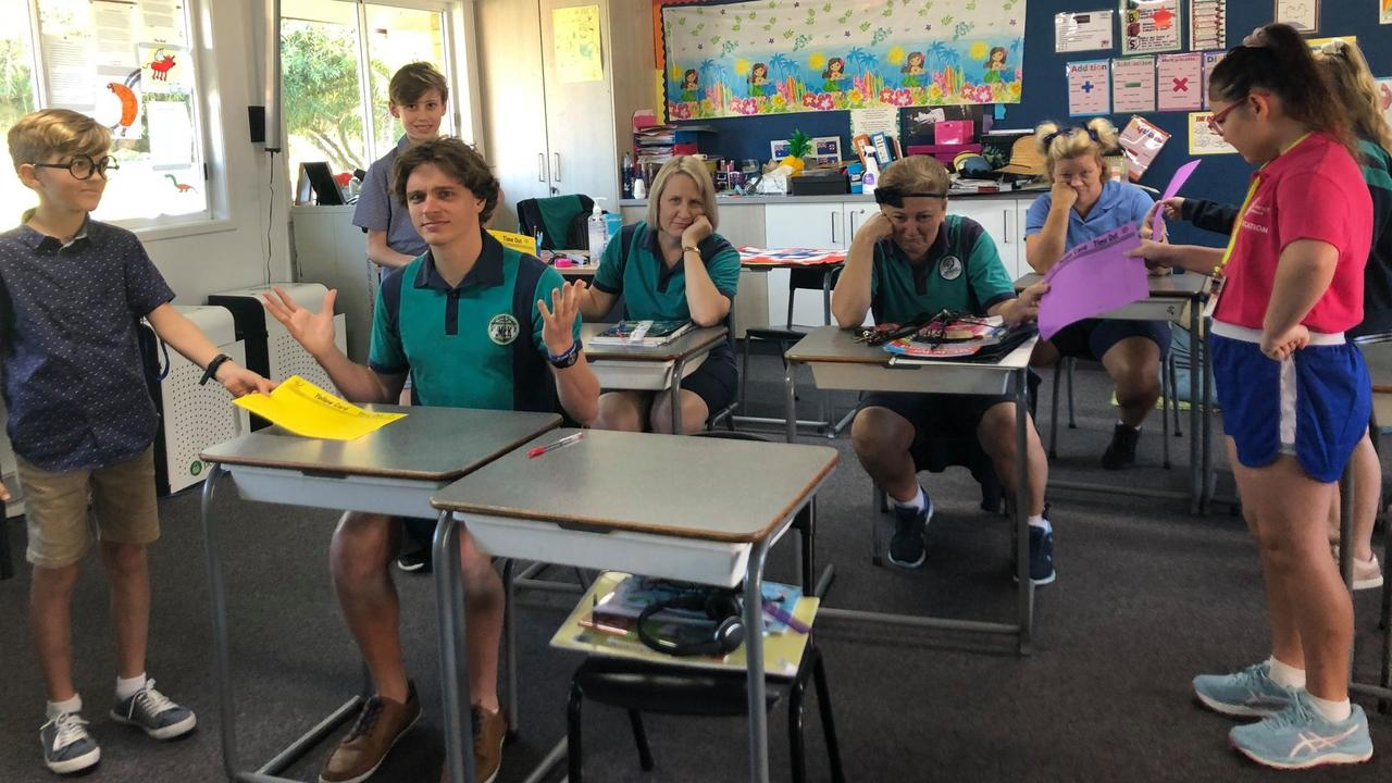 MacKillop Catholic Primary School students flipped roles to become the teachers for the day including (from front left) Max Gauci, Saige Sharpe (and from back left), Christian Nield and Cassidy Blakey. Teachers got in on the fun dressing up in school uniform including (front) year four teacher Darcy Rowen, (middle row) principal Allison Blakely, year one teacher Jo Parker and (back) year five tea
