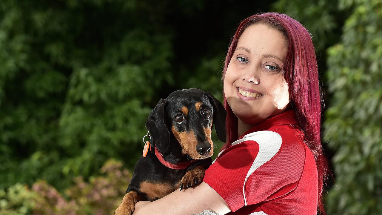 34-year-old Sami Heit, pictured with her dog Benji, lives with cystic fibrosis and has had a lung transplant. May is National Cystic Fibrosis Awareness Month. PICTURE: MATT TAYLOR.