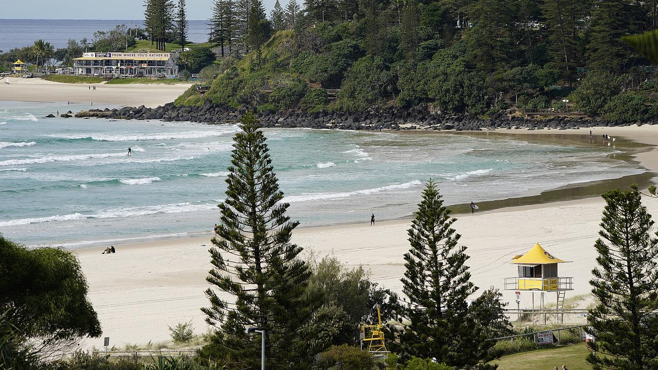 Coolangatta is usually bustling at this time of year, but barely anyone was at the beach last Friday. Picture: AAP Image/Dave Hunt