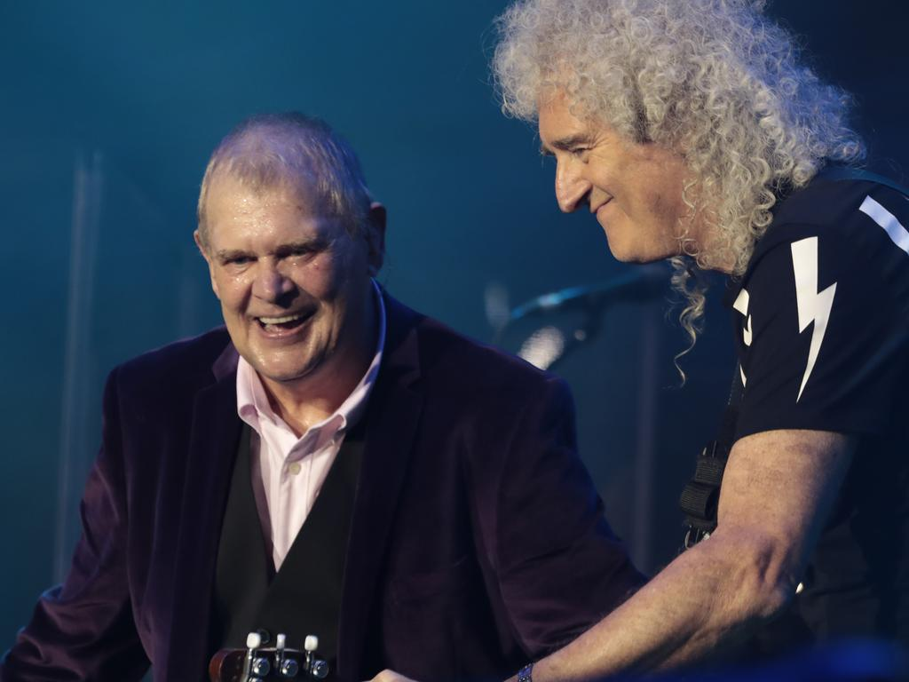 John Farnham (L) and Brian May of Queen (R) perform during Fire Fight Australia at ANZ Stadium in Sydney, Australia. Picture: Getty Images