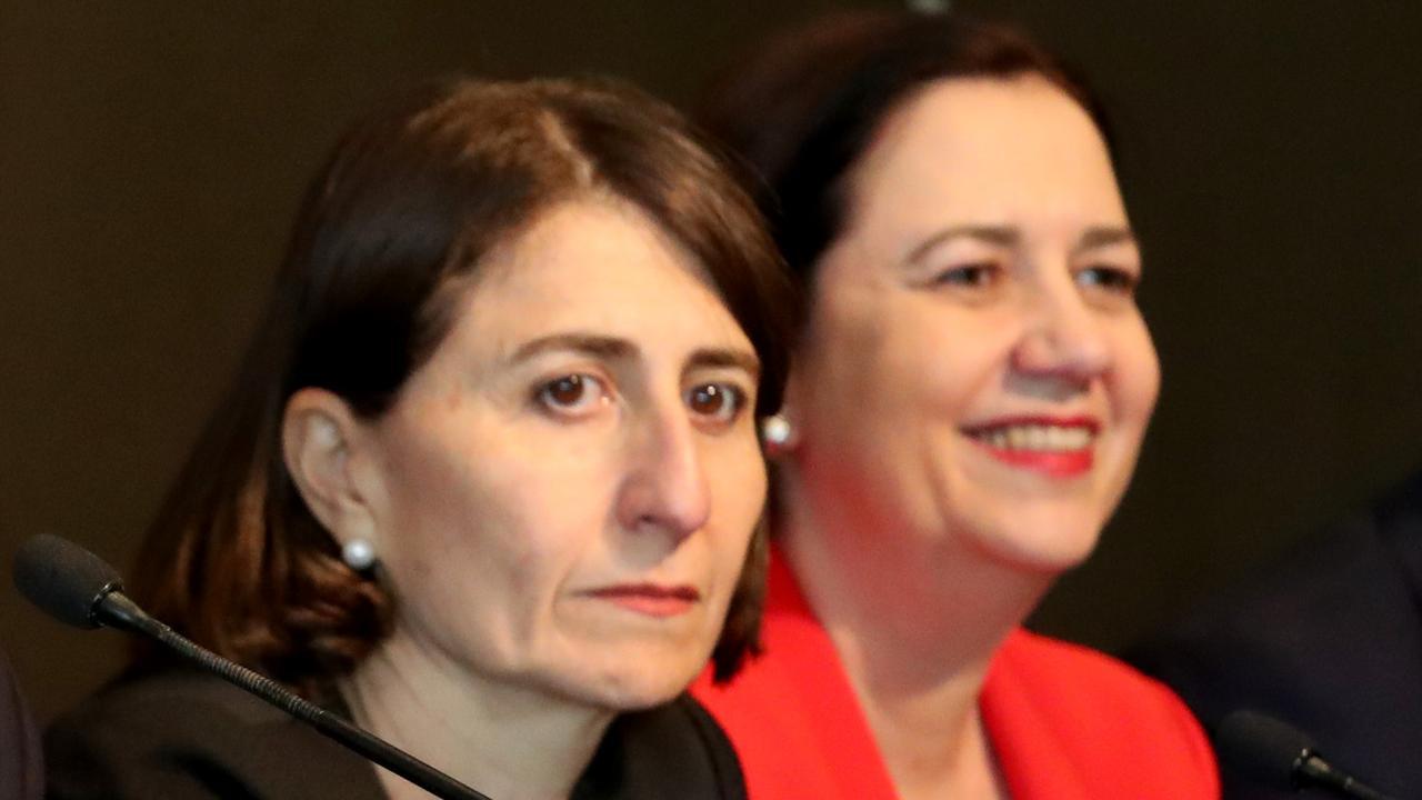 NSW Premier Gladys Berejiklian and Queensland Premier Annastacia Palaszczuk. Picture: AAP/Kelly Barnes
