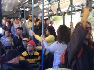 Viral sardines: Photos emerge of packed QLD bus