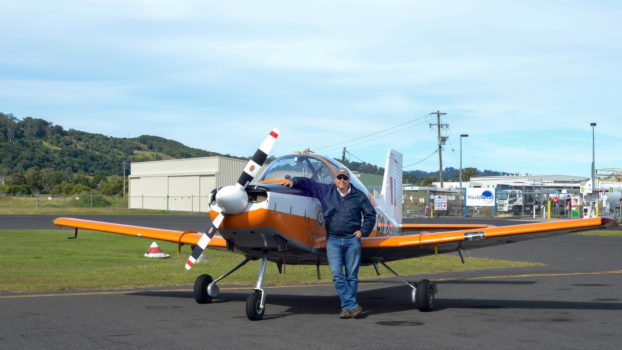 PLASTIC PARROT: Garry Herne with his brightly painted CT-4 basic trainer, in which a generation of Australian Defence Force (ADF) pilots made a first, anxious solo flight. Picture: Cath Piltz