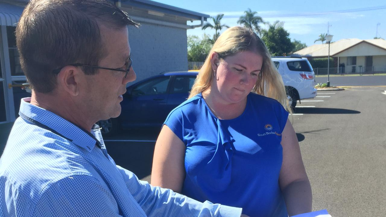 Member for Bundaberg David Batt and Burnett Bowls Club's Kellie Kemp discussing daily changes in Queensland's COVID Road to Recovery plan.
