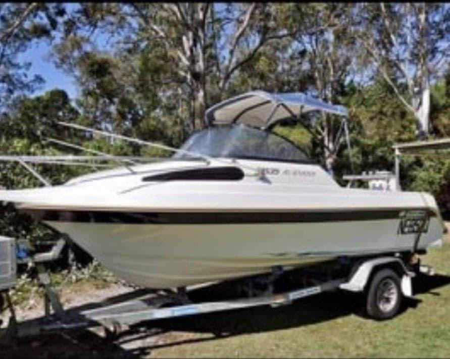 The man's boat is a white 2002 Yalta 5.4 metre half cabin powerboat – registration #NE852Q.