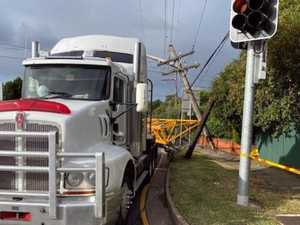 Unsecure load breaks power pole, leaves wires on road