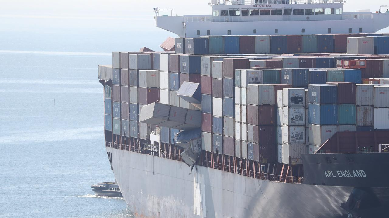 Containers were hanging off the APL England ship as it docked after coming under fire from authorities for allowing 75 containers to tumble into the ocean.