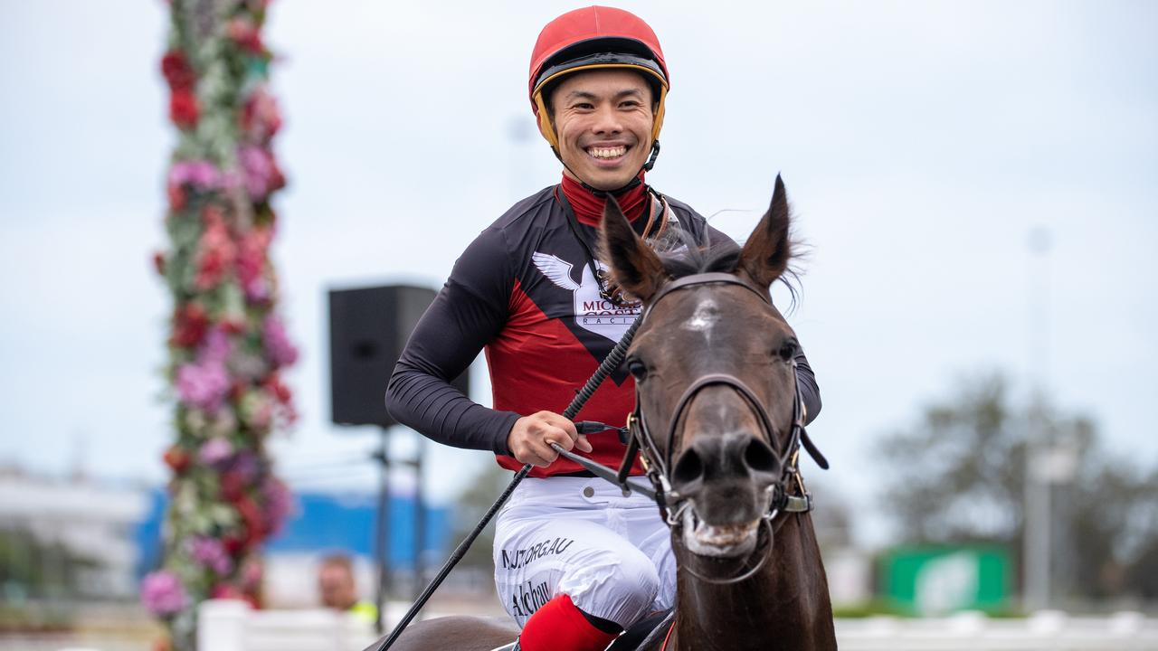 Jockey Allan Chau returns to scale after riding Supergiant to victory. Picture: AAP Image/Supplied by Michael McInally, Racing Queensland
