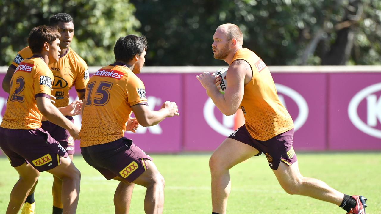 Matt Lodge (right) heads for contact at training. Picture: Darren England/AAP