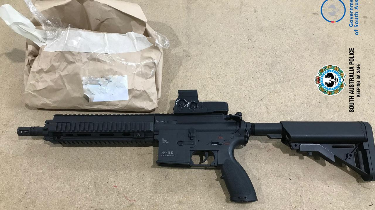 A realistic-looking gun was used in gel blaster attack on three pedestrians on Monday evening, with police arresting a man and searching for a second suspect.