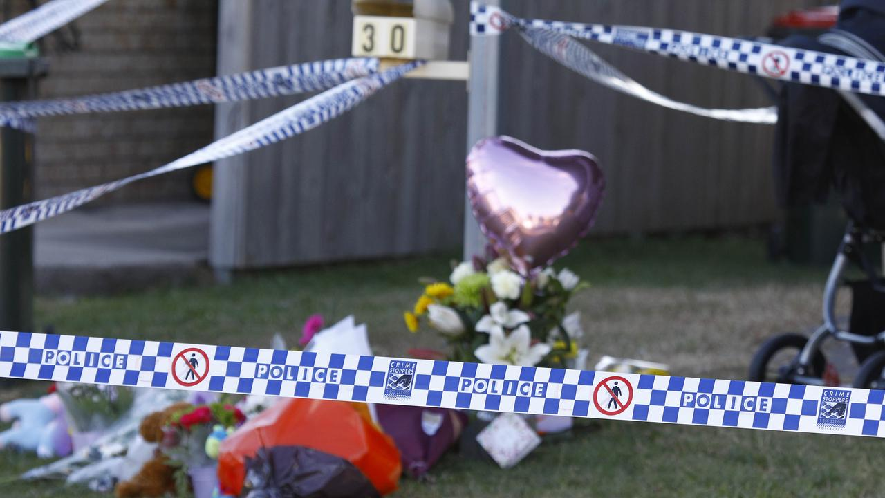 Members of the public with flowers outside the home where the body of Willow Dunn was found. Picture: Tertius Pickard.