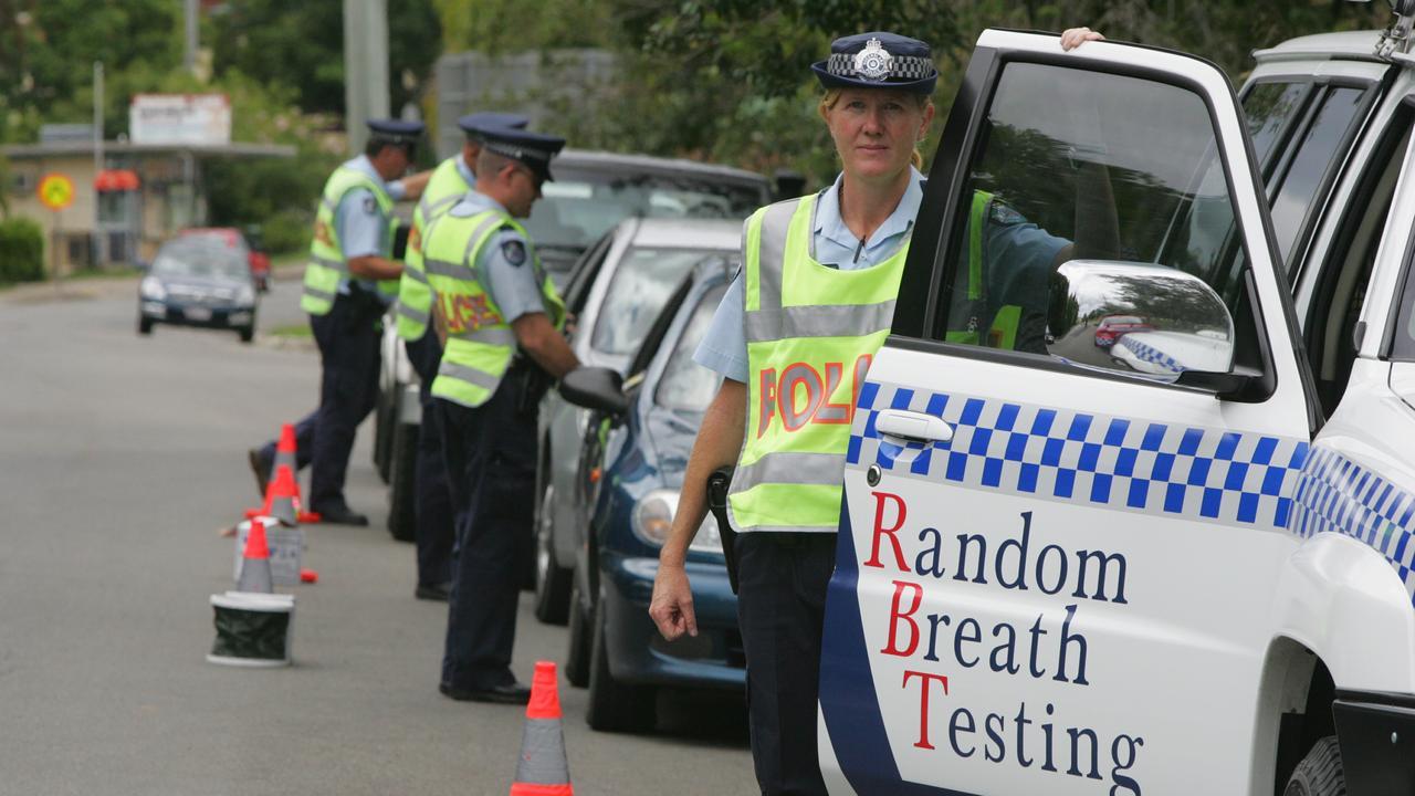 Traffic police conduct random breath testing (RBT's).
