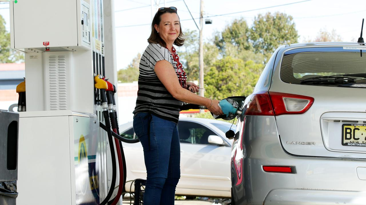 Amanda Morey filling up with E10, for 91.9 cents per litre. The RACQ has warned not to expect prices to drop to previous lows. Picture: Jonathan Ng