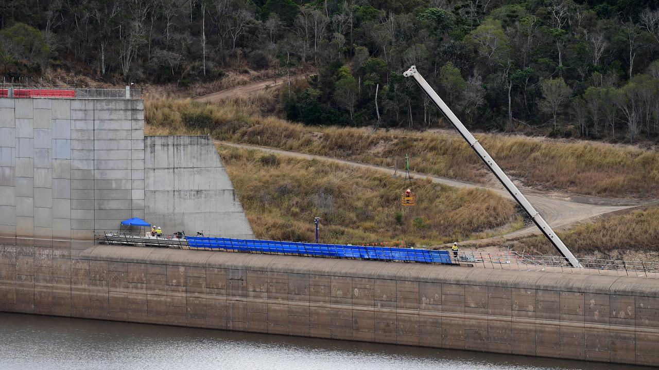 Work began on lowering Paradise Dam's spillway from Monday. Picture: Mike Knott.