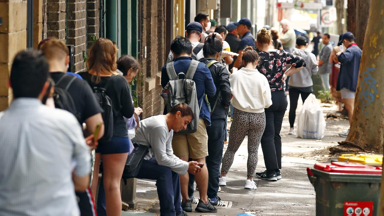 Queues of people wait outside Centrelink in March. Picture: Sam Ruttyn