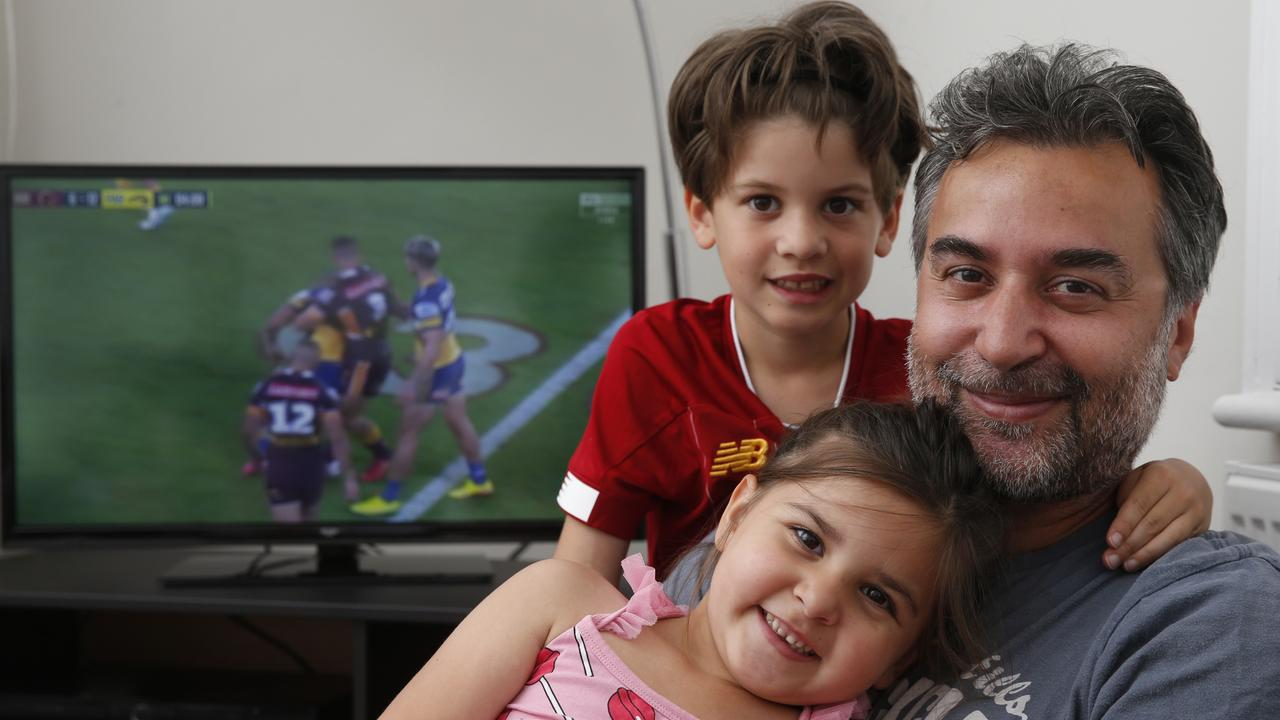 Basak Yagci watching the NRL in his London home with son Kaya and daughter Lara. Picture: Hollie Adams