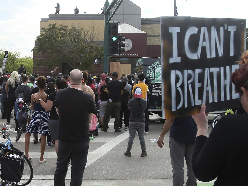 Demonstrators outside the Minneapolis Police Third Precinct. Picture: Jim Mone/AP