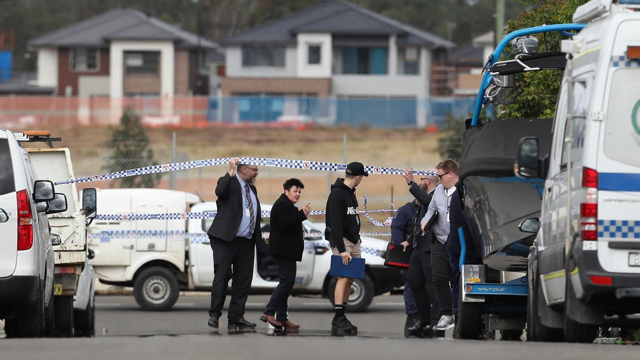 Police in Langton St Riverstone where a 39-year-old man was murdered in an alleged home invasion. Picture: David Swift.