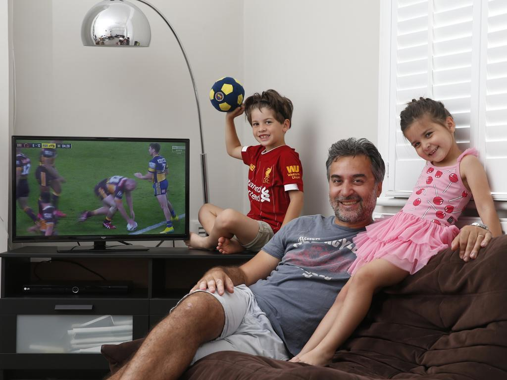 The sports-starved British family were happy to see a game on TV, even if they didn't understand all of the rules. Picture: Hollie Adams