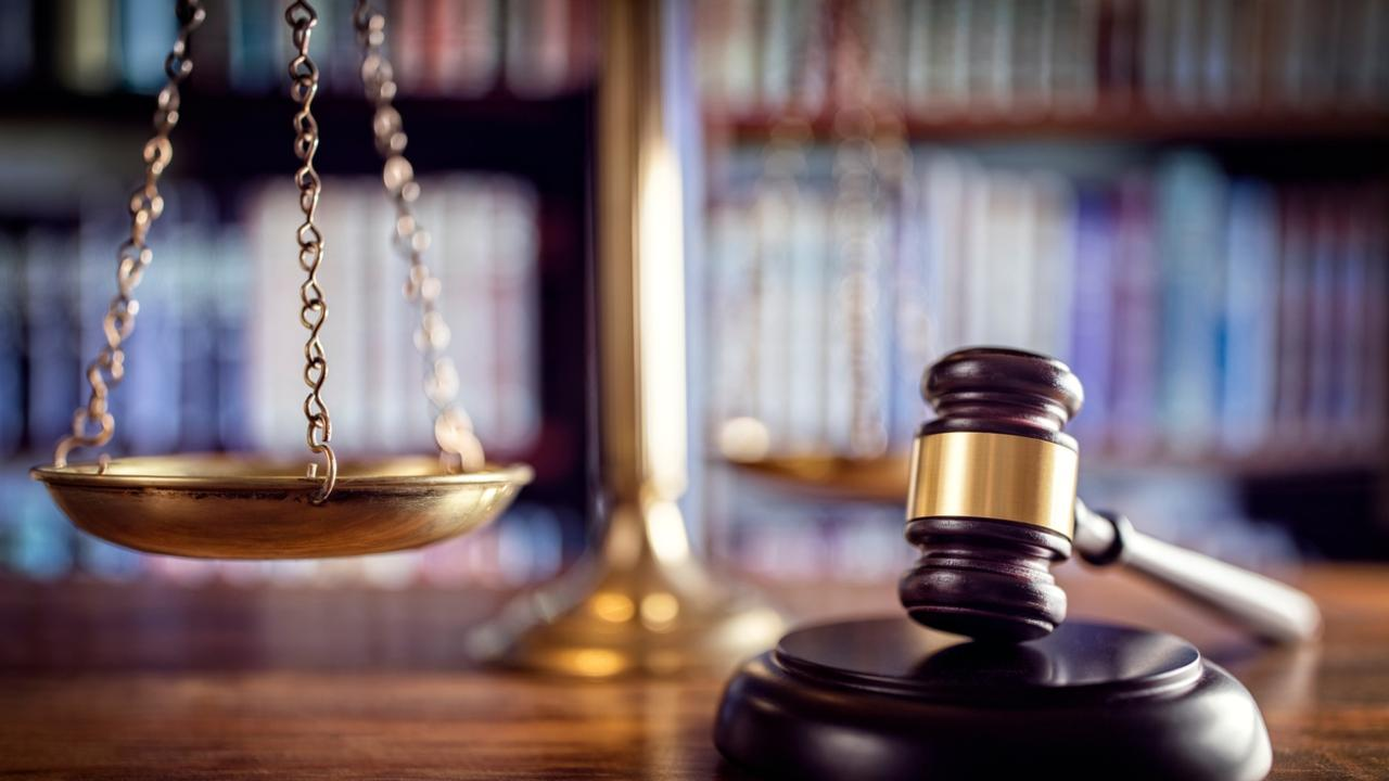 Gavel, scales of justice and law books
