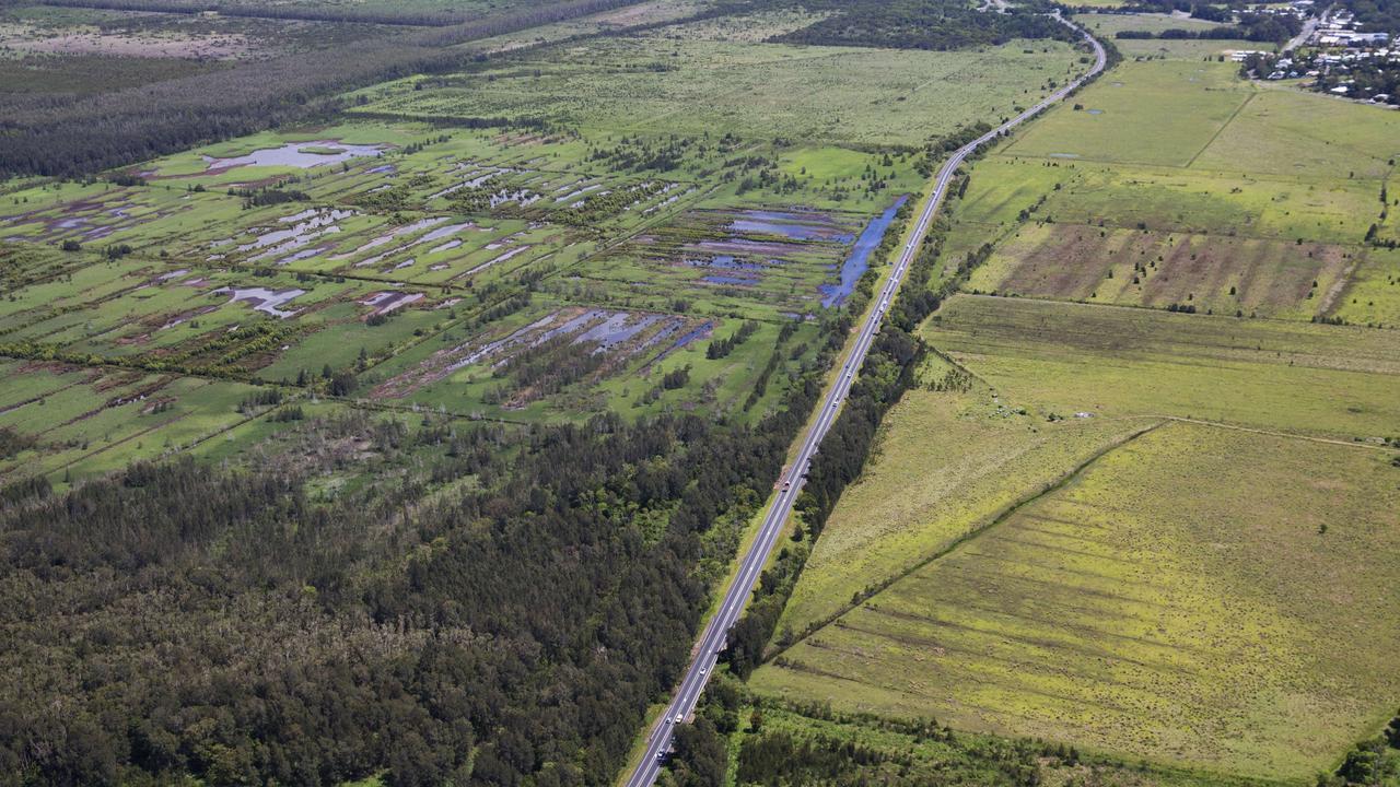 Aerial view over the Sunshine Motorway through farming land at Coolum. Photo Lachie Millard