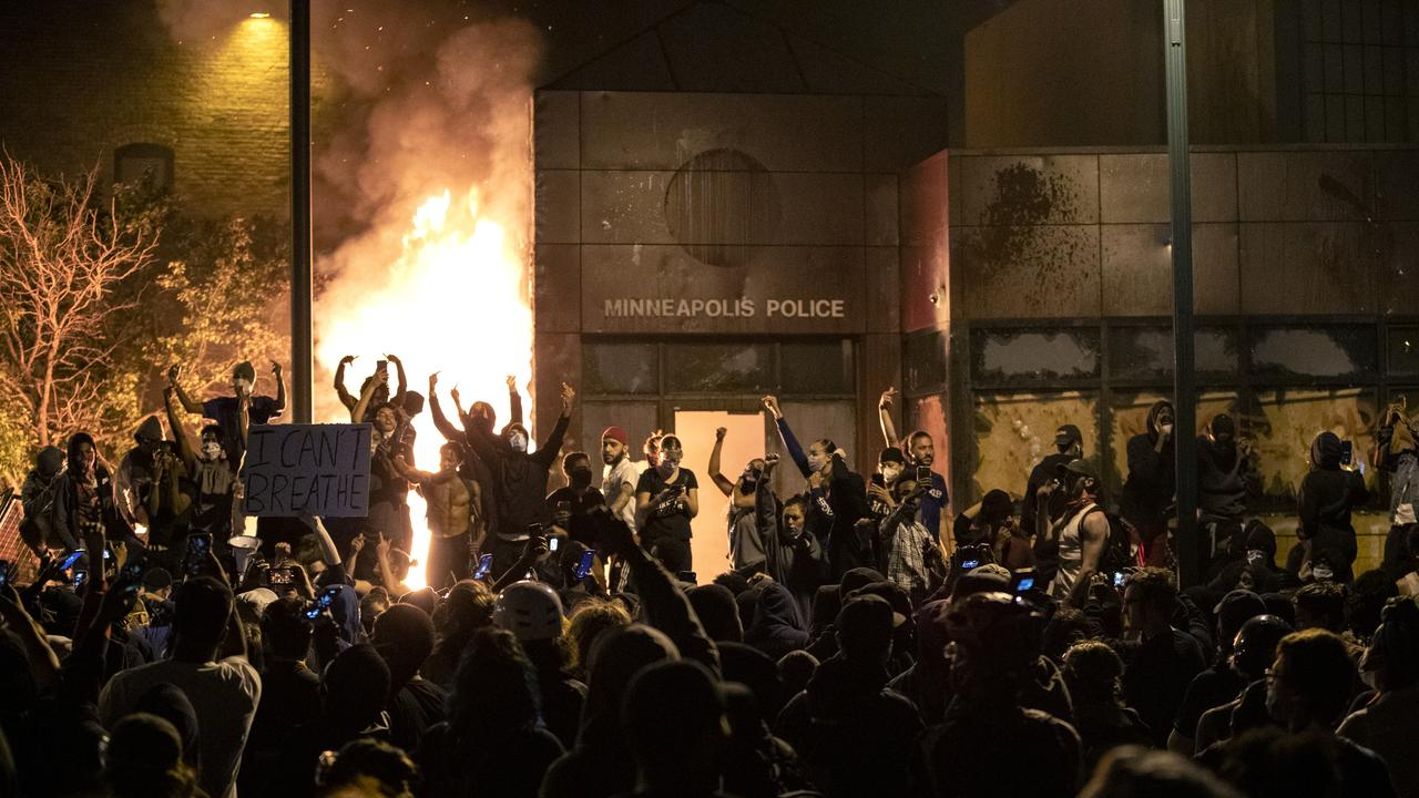 Protesters gesture after the Minneapolis police 3rd Precinct building was set on fire Thursday night, during demonstrations over the Monday death of George Floyd in Minneapolis police custody. Picture: AP
