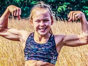 Tiny gymnast shows of her incredible six-pack physique