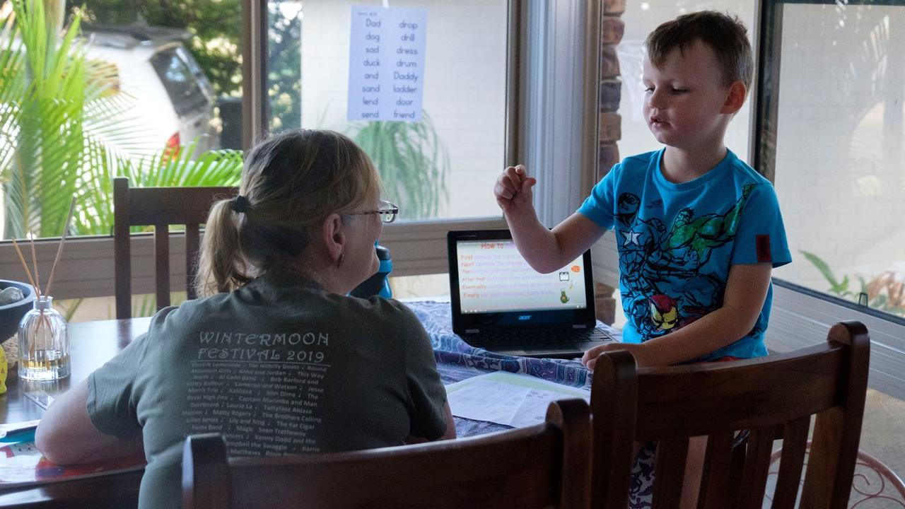 HOMESCHOOLING: Kerry Jones helping grandson Oliver Lincoln with his schooling.