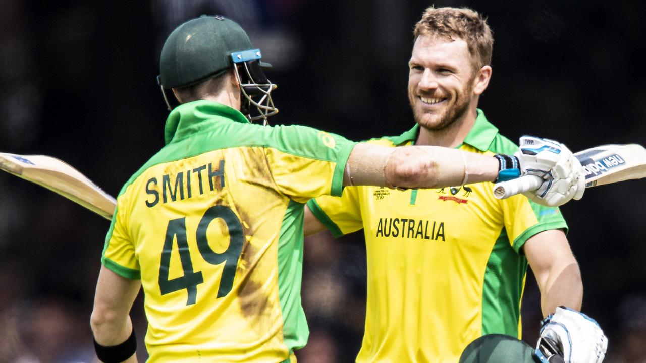 LONDON, ENGLAND - JUNE 25: Aaron Finch of Australia (R) celebrates reaching his century with team mate Steve Smith during the Group Stage match of the ICC Cricket World Cup 2019 between England and Australia at Lords on June 25, 2019 in London, England. (Photo by Andy Kearns/Getty Images)