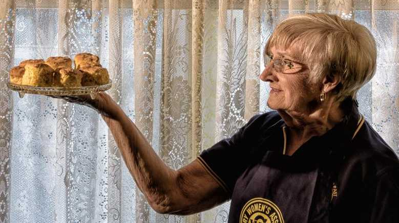 Jan Gillett looks at a batch of her freshly baked pumpkin scones that took her to the front page of the local phone book.