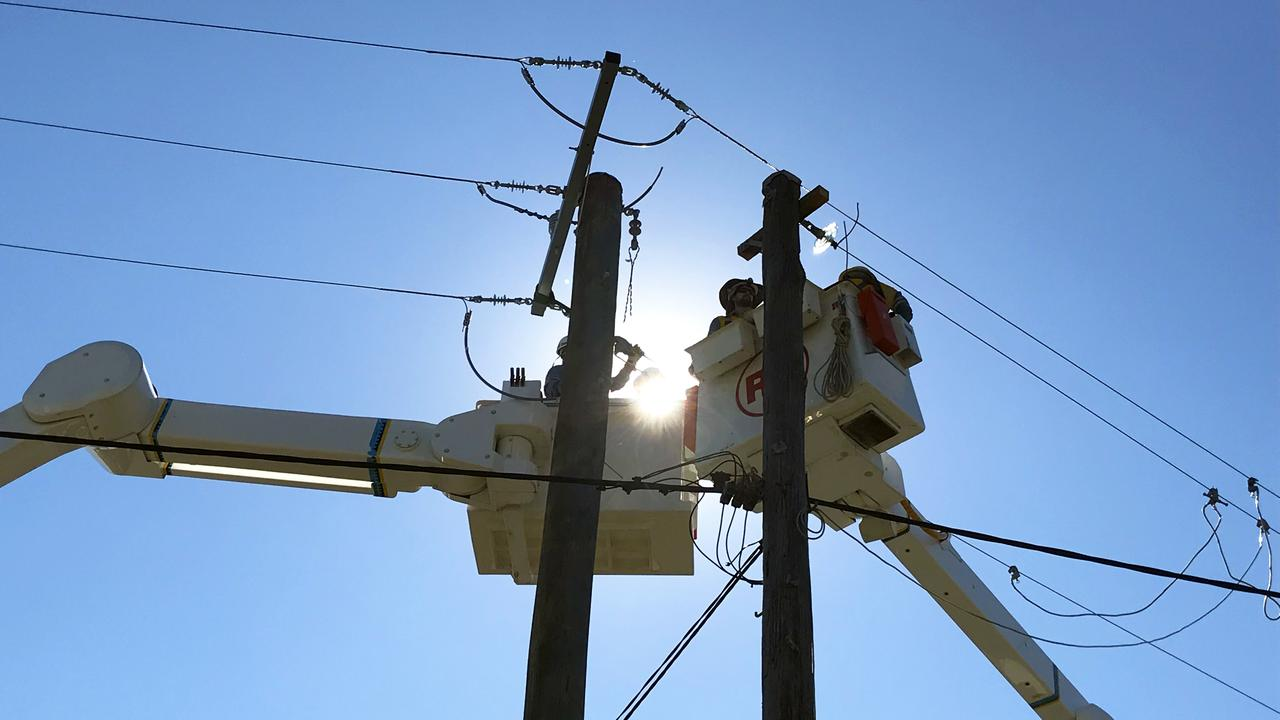 Energex crews are on scene after a car brought down a powerline in the Lockyer Valley..