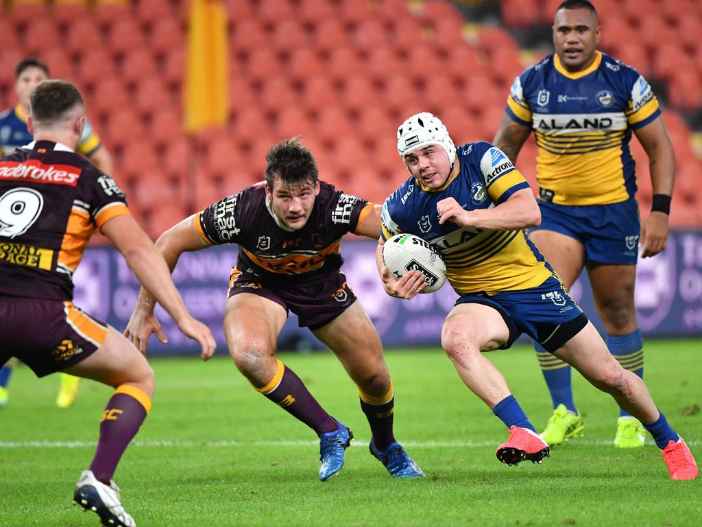 Sunshine Coast junior Reed Mahoney is runs at the Brisbane Broncos line. Photo: Darren England