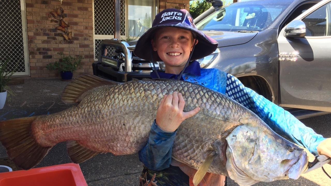 Mitchell Kling with the 103cm barramundi he caught in the Burnett River recently