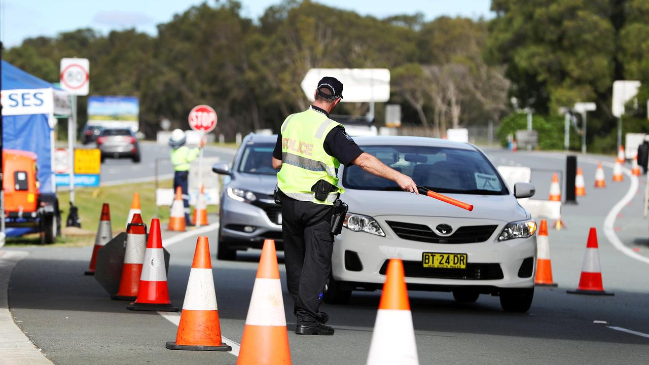 Police checking people crossing the Queensland / New South Wales border. Picture: Nigel Hallett