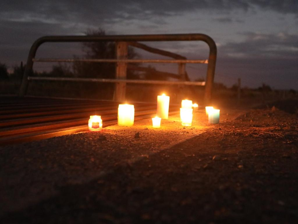 Residents lit candles in memory of Mr Turner. Picture: Steve Vit