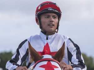 Jockey in neck brace after fall in Caloundra race
