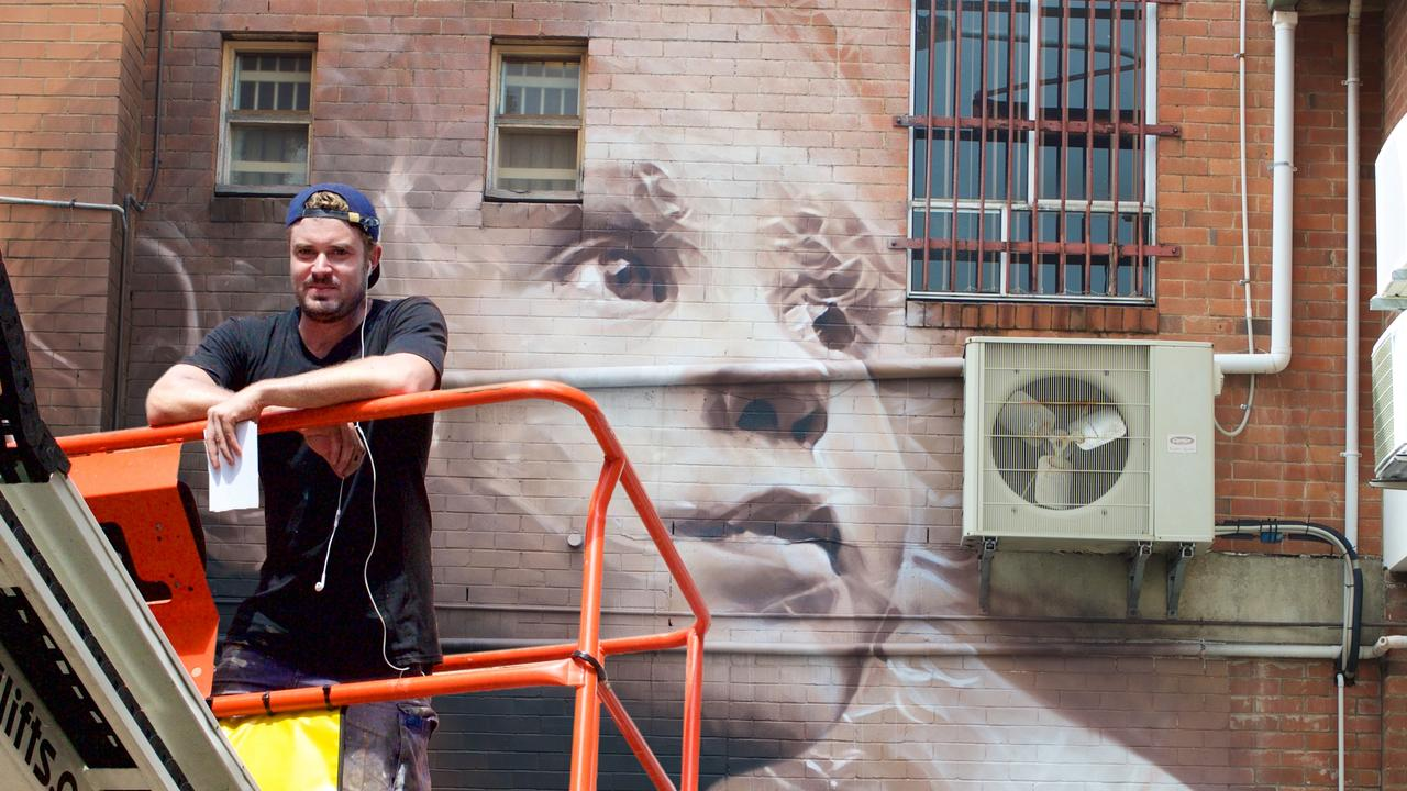 Street Artist, Guido Van Helten transforms the sides of buildings into breathtaking portraits,