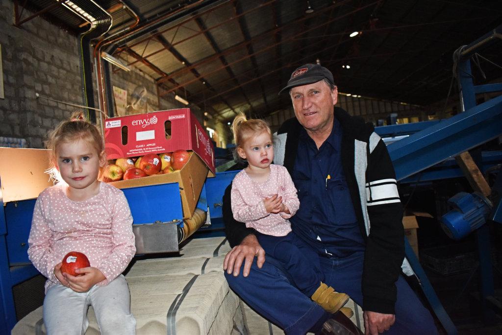Image for sale: John Savio with grandkids Charlotte and Heidi.
