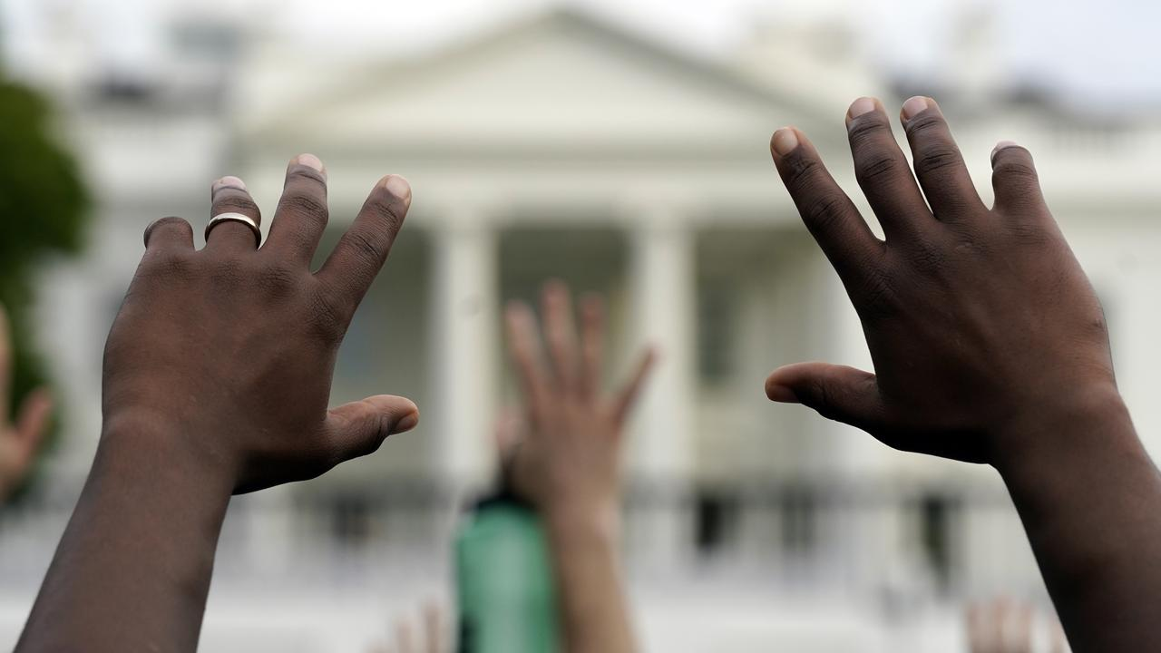 Demonstrators gather across from the White House. Picture: AP Photo/Evan Vucci